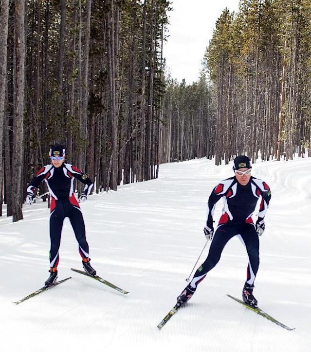 In this photo taken on Monday, Jan. 27, 2014, cross-country skiers Gary, right, and Angelica di Silvestri ski at the Yellowstone Club in Big Sky, Mont. The American-born man and his Italian-born wife will be representing the tiny Caribbean island nation of Dominica at the Winter Olympics in Sochi next month. The former finance professionals, granted Dominica citizenship for their philanthropic work on the island, are finishing their training in Montana while hastily arranging their own visas, travel logistics and footing the bill for the entire expedition. (AP Photo/Janie Osborne)