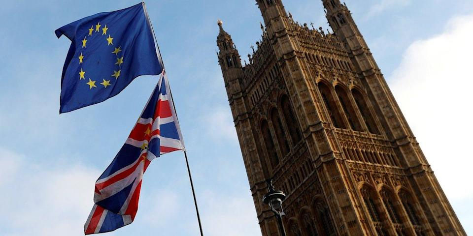 Protesters wave the EU and Union flags outside the Palace of Westminster, London, Britain, December 20, 2017