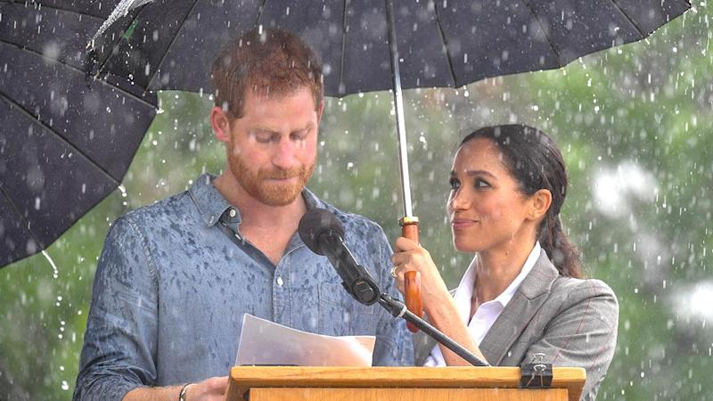 Royals Harry and Meghan go barefoot on Bondi