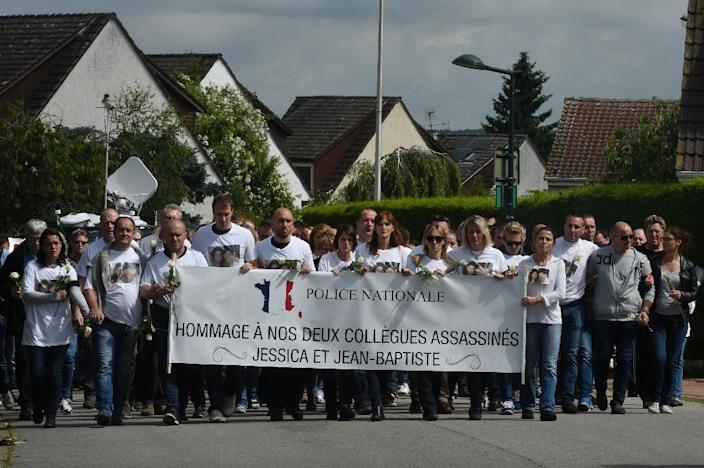 People and policemen gather outside the victims' house during a march in the Paris suburb of Magnanville, on June 16, 2016, in tribute to French policeman Jean-Baptiste Salvaing and his partner Jessica Schneider killed outside their home (AFP Photo/Dominique Faget)