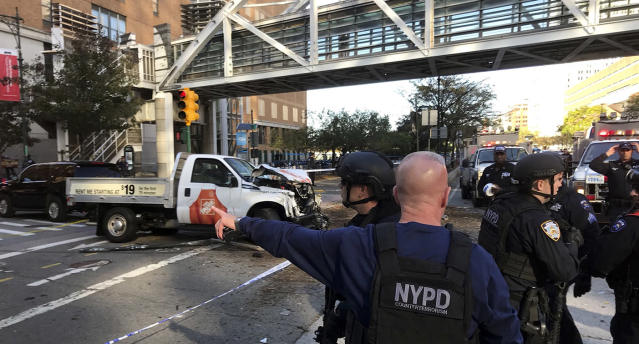 <p>New York City Police Officers respond to a report of gunfire along West Street near the pedestrian bridge at Stuyvesant High School in lower Manhattan in New York, Oct. 31, 2017. (Martin Speechley/NYPD via AP) </p>