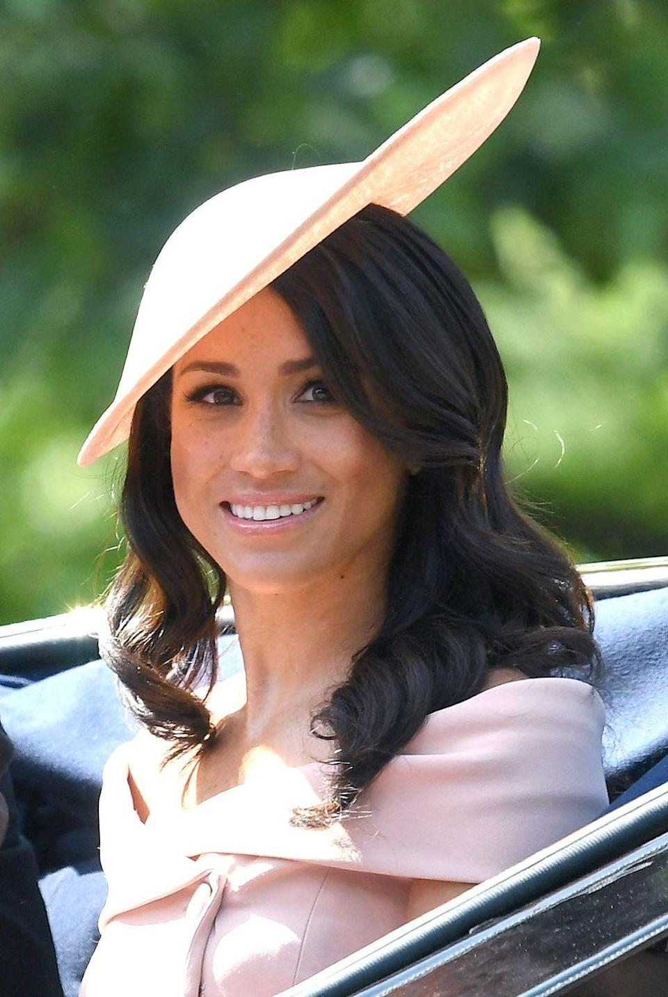 <p>Markle perfected the curling iron ringlet at the Trooping of the Colour event in 2018.</p>