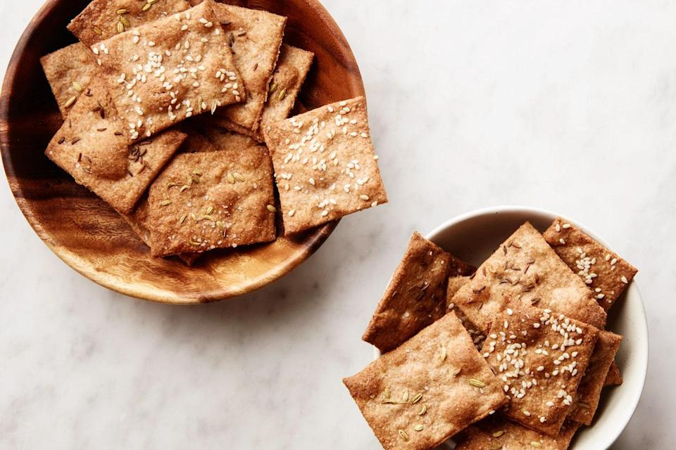 """These crackers aren't super crumbly or messy, and they stand up well to a hearty dip. (They're also delicious on their own, so you might want to bring a bunch.) <a href=""""https://www.epicurious.com/recipes/food/views/3-ingredient-seeded-crackers?mbid=synd_yahoo_rss"""" rel=""""nofollow noopener"""" target=""""_blank"""" data-ylk=""""slk:See recipe."""" class=""""link rapid-noclick-resp"""">See recipe.</a>"""