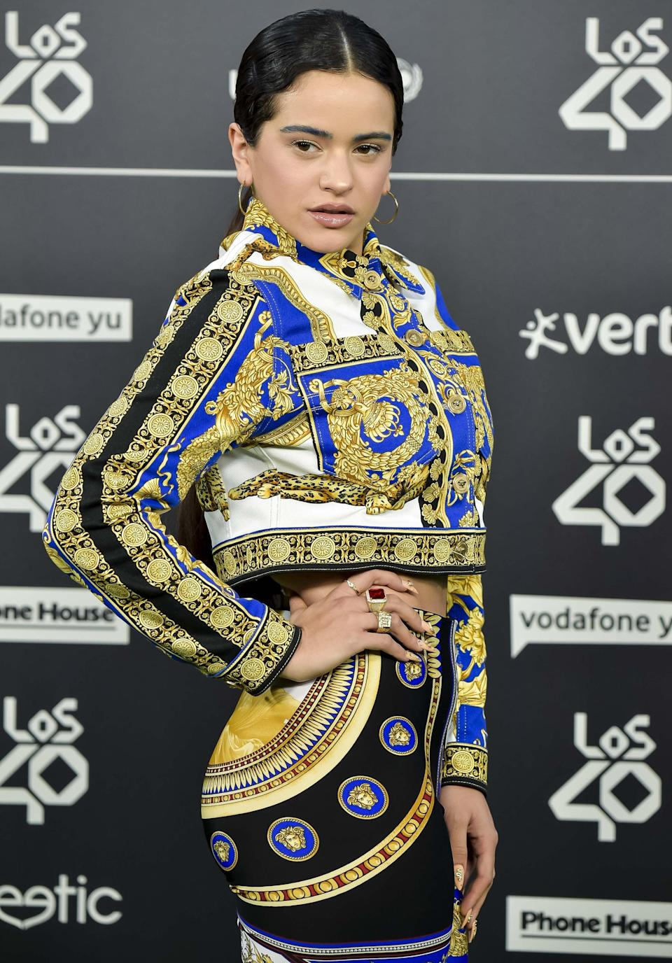 <p>Rosalía matched her makeup with her outfit by tinting her eyebrows a light shade of blue and wearing yellow eyeliner.</p>