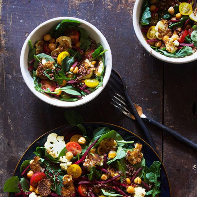 """<p>Ready to turn up the heat? Full of arugula, cauliflower, chickpeas, beets, and quinoa, all topped with a homemade jalapeño dressing — that's the recipe for a beautiful lunch that'llhelp power you through theday.<br></p><p><strong>Get the recipe at <a rel=""""nofollow"""" href=""""http://www.bakersroyale.com/power-salad-with-jalapeno-dressing/"""">Bakers Royale</a>.</strong></p>"""