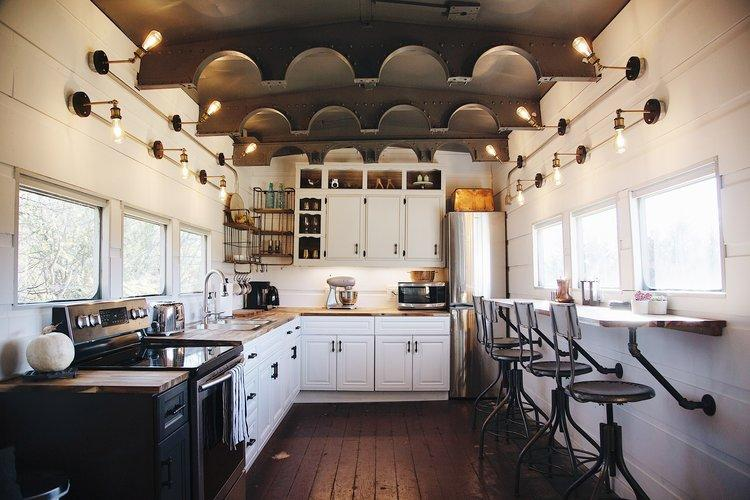 The ceiling has original archways that used to hang water tanks. Photo credit: Airbnb.