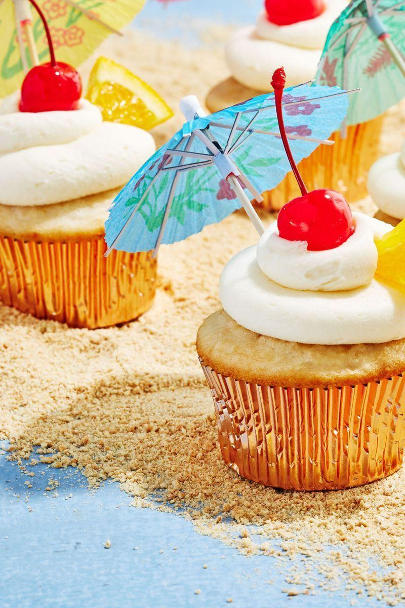 """<p>Bahama Mama cupcakes turn your favourite summertime drink into the perfect dessert. One bite and you'll feel like you've had the beach vacation of your dreams. Have a Bahama Mama cupcake in one hand and <a href=""""https://www.delish.com/uk/cooking/recipes/a28795743/margarita-cupcakes-recipe/"""" rel=""""nofollow noopener"""" target=""""_blank"""" data-ylk=""""slk:Margarita Cupcake"""" class=""""link rapid-noclick-resp"""">Margarita Cupcake</a> in the other!</p><p>Get the <a href=""""https://www.delish.com/uk/cooking/recipes/a34295919/bahama-mama-cupcakes-recipe/"""" rel=""""nofollow noopener"""" target=""""_blank"""" data-ylk=""""slk:Bahama Mama Cupcakes"""" class=""""link rapid-noclick-resp"""">Bahama Mama Cupcakes</a> recipe.</p>"""