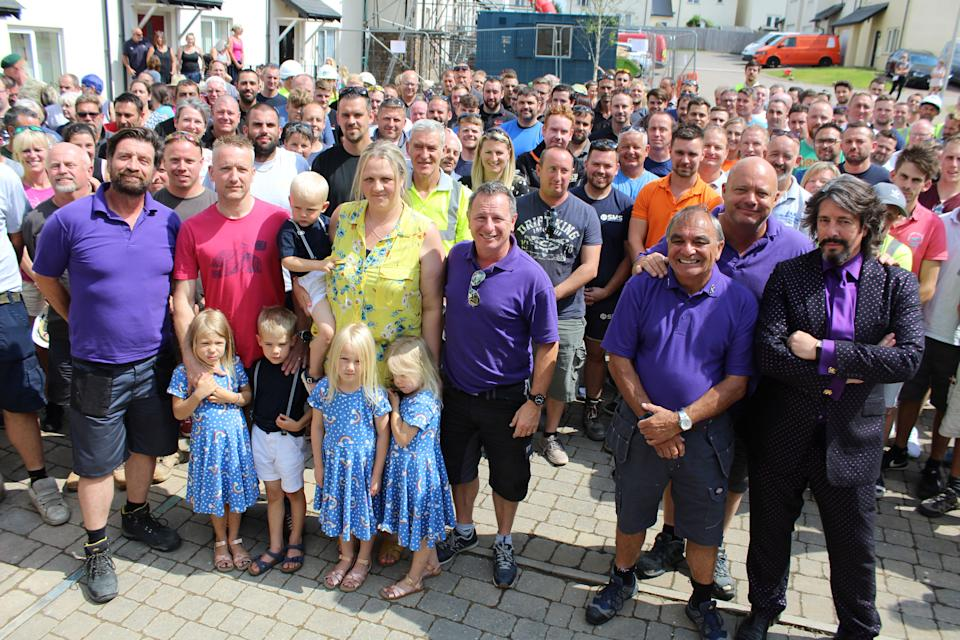 The family with the DIY SOS team and volunteers  (BBC/Hamish Summers)