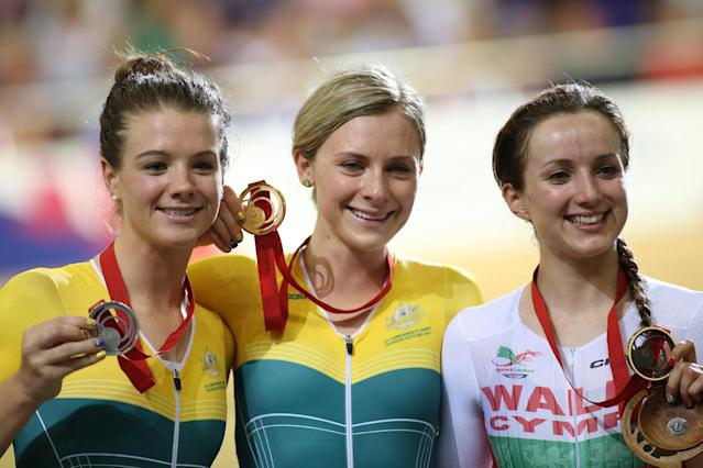 Australia's gold medalist Annette Edmondson, center, poses for photographers with teammate and silver medalist Amy Cure, left, and bronze medalist Wales' Elinor Barker, after the Womens's Sprint final at the Chris Hoy velodrome, during the Commonwealth Games Glasgow 2014, Scotland, Saturday July 26, 2014. (AP Photo/Peter Morrison)
