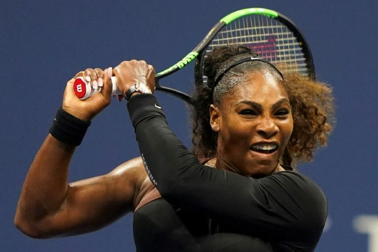 Sister act: Serena Williams on the way to a US Open third-round victory over her sister Venus