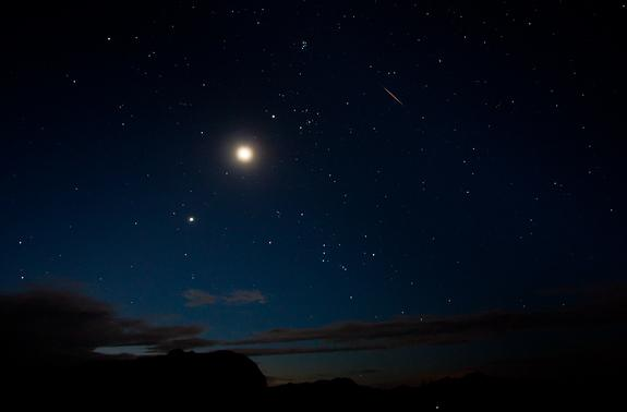 The moon and Venus shine bright alongside a Perseid meteor (upper right) on Aug. 12 in this view by photographer Tyler Leavitt in Las Vegas, Nevada, during the peak of the 2012 Perseid meteor shower on Aug. 12.