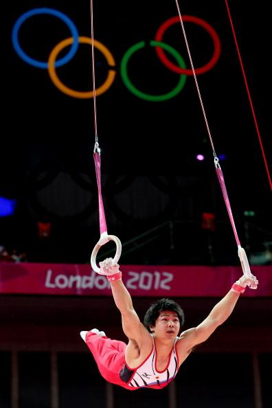 LONDON, ENGLAND - JULY 30:  Koji Yamamuro of Japan competes on the rings in the Artistic Gymnastics Men's Team final on Day 3 of the London 2012 Olympic Games at North Greenwich Arena on July 30, 2012 in London, England.  (Photo by Ronald Martinez/Getty Images)