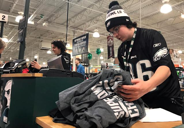 A cashier rings up Philadelphia Eagles commemorative Super Bowl shirts at DickÕs Sporting Goods in Fairless Hills, Pennsylvania, U.S. February 5, 2018. REUTERS/Suzanne Barlyn