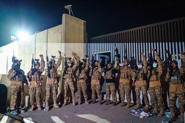 <strong>Taliban fighters from the Fateh Zwak unit celebrate before storming into the Kabul International Airport, wielding American supplied weapons, equipment and uniforms after the United States Military have completed their withdrawal, in Kabul, Afghanistan.</strong> (Photo: Marcus Yam via Getty Images)
