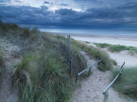 The beach and dunes here stretch for miles in both directions - Credit: GETTY