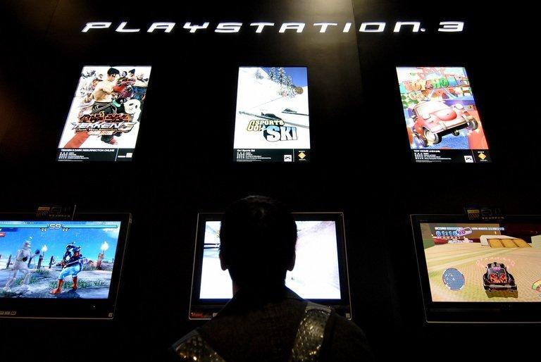 A gamer at the Sony Playstation booth at the Asian Game Show in Hong Kong, on December 22, 2007