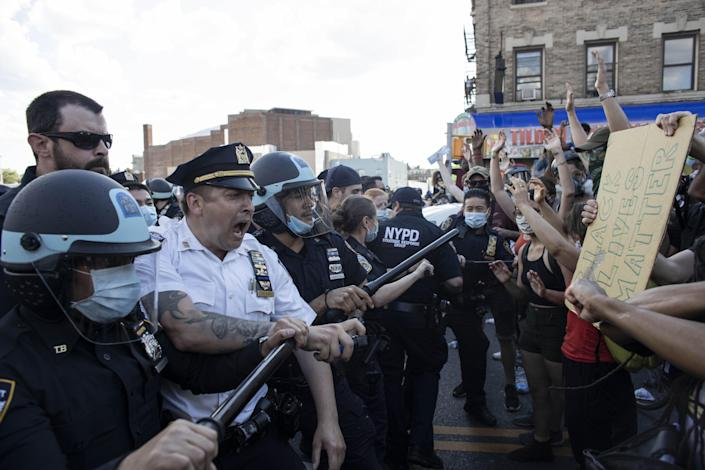 Protesters confront police officers in New York City, May 30, 2020. (Mostafa Bassim/Anadolu Agency via Getty Images)
