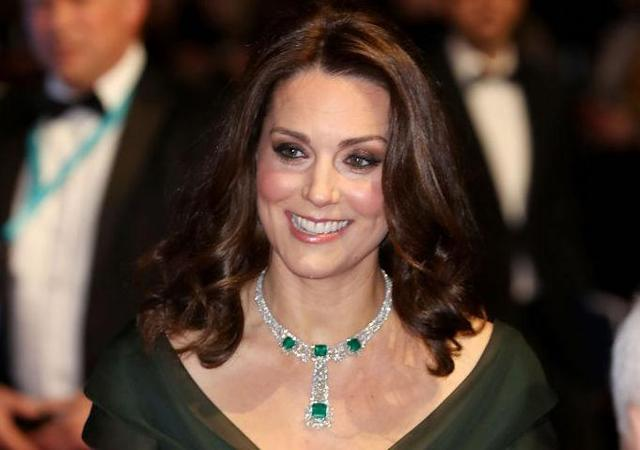 The Duchess of Cambridge opted for a bottle green gown by Jenny Packham for the 2018 BAFTAs award show. [Photo: Getty]