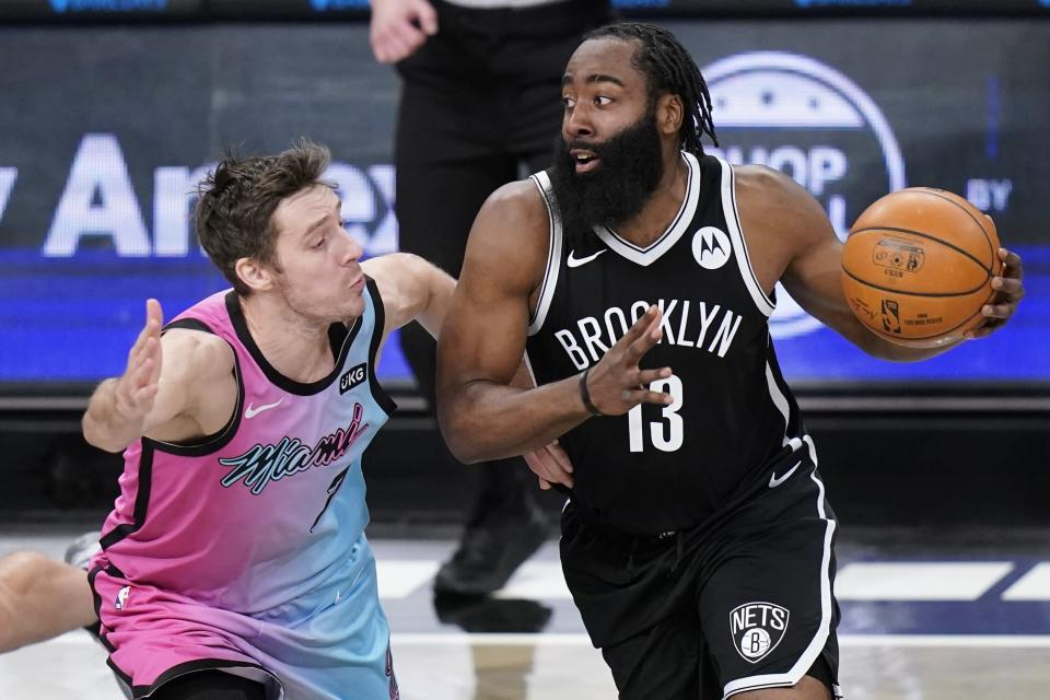 Miami Heat's Goran Dragic, left, defends against Brooklyn Nets' James Harden, right, during the first half of an NBA basketball game Saturday, Jan. 23, 2021, in New York. (AP Photo/Frank Franklin II)