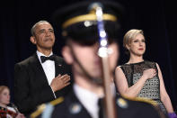<p>President Obama and Carol Lee of the Wall Street Journal listen to the national anthem at the annual White House Correspondents' Dinner, April 30.<i> (Photo: Susan Walsh/AP)</i></p>