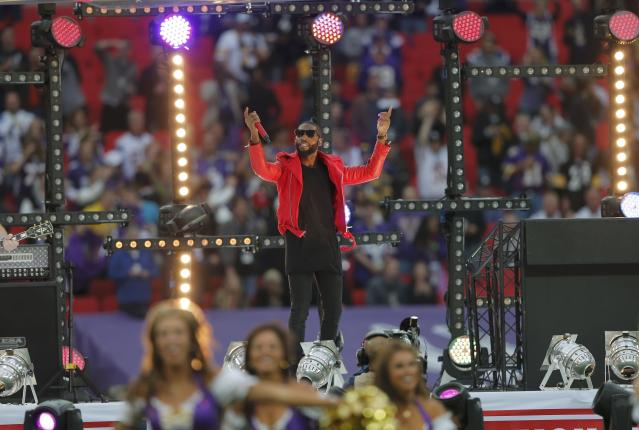 British rapper Tinie Tempah performs before the Minnesota Vikings met the Pittsburgh Steelers in their NFL football game at Wembley Stadium in London, September 29, 2013. REUTERS/Eddie Keogh (BRITAIN - Tags: SPORT FOOTBALL)