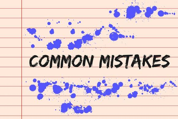 lined paper on which are the words common mistakes as well as some purple ink spills