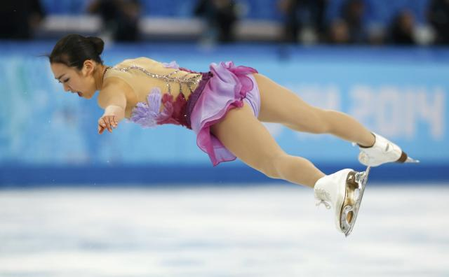 Mao Asada of Japan competes during the figure skating team ladies short program at the Sochi 2014 Winter Olympics, February 8, 2014. REUTERS/Alexander Demianchuk (RUSSIA - Tags: SPORT FIGURE SKATING OLYMPICS)