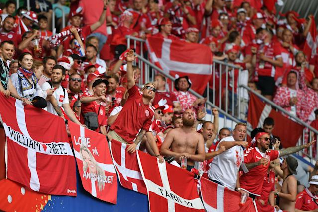 Denmark fans are seen behind their flags before kick off of the Russia 2018 World Cup Group C football match between Denmark and Australia at the Samara Arena in Samara on June 21, 2018. (Getty Images)
