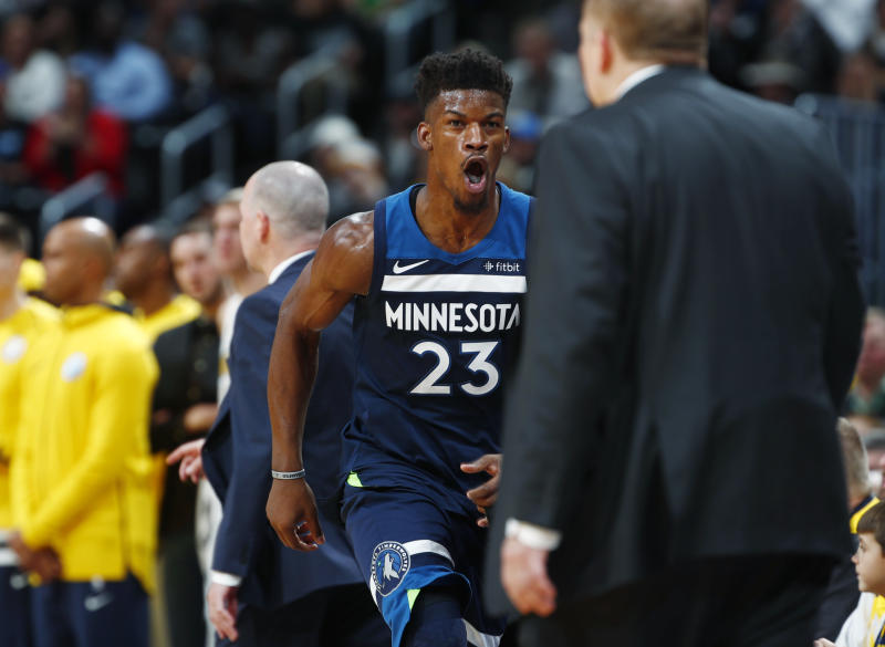 Minnesota Timberwolves guard Jimmy Butler (23) runs back to the bench and head coach Tom Thibodeau after hitting a key basket against the Denver Nuggets with 41 seconds remaining in the second half of an NBA basketball game Wednesday, Dec. 20, 2017, in Denver. The Timberwolves won 112-104. (AP Photo/David Zalubowski)