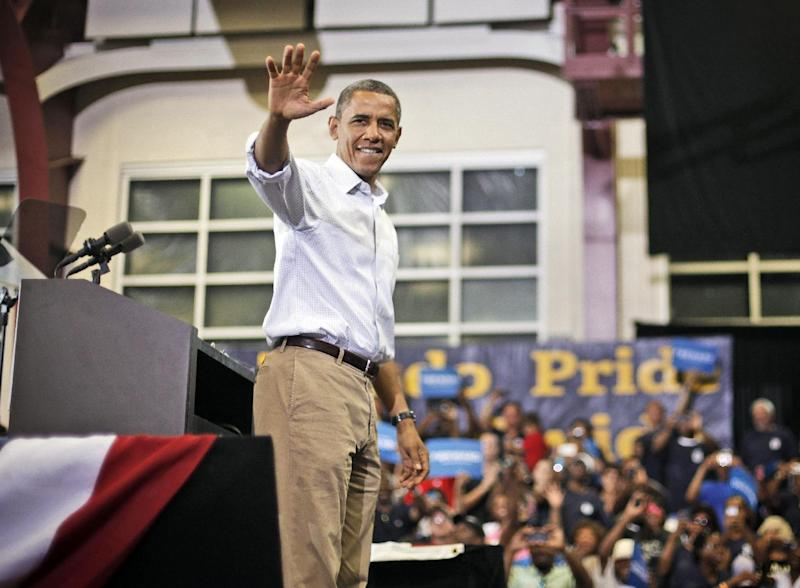 President Barack Obama waves to supporters after speaking a campaign event at Scott High School, Monday, Sept. 3, 2012, in Toledo, Ohio. (AP Photo/Pablo Martinez Monsivais)