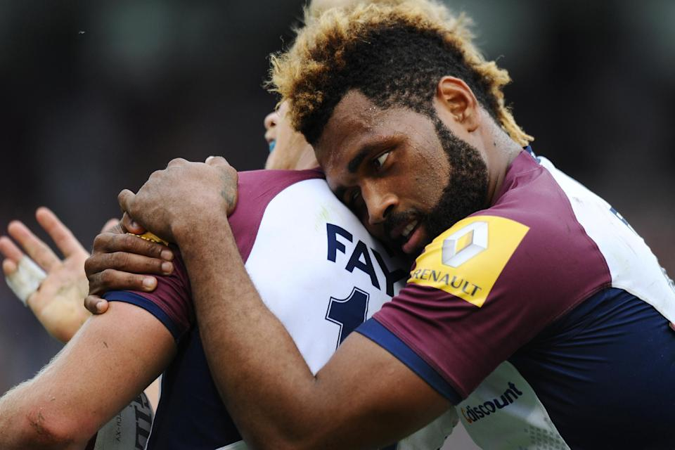 Bordeaux's Metuisela Talebula celebrates with teammate Blair Connor (L) during their French Top 14 rugby union match against Castres, at the Chaban-Delmas stadium in Bordeaux, southwestern France, on October 11, 2014 (AFP Photo/Nicolas Tucat)