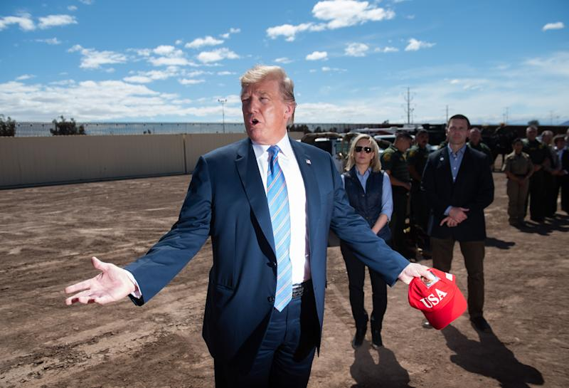 US President Donald Trump tours the border wall between the United States and Mexico in Calexico, California, April 5, 2019. - President Donald Trump landed in California to view newly built fencing on the Mexican border, even as he retreated from a threat to shut the frontier over what he says is an out-of-control influx of migrants and drugs. (Photo by SAUL LOEB / AFP) (Photo credit should read SAUL LOEB/AFP/Getty Images)