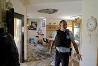 This house in the Israeli town of Netivot was damaged by one of the hundreds of rockets fired from Gaza (AFP Photo/MENAHEM KAHANA)