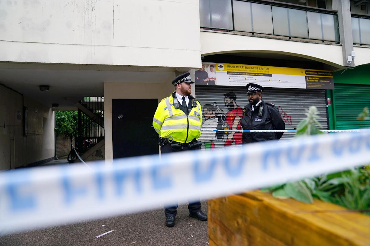 Police near to the scene in Lambeth, south London, where a 16-year-old boy died after being stabbed on Monday evening. Picture date: Tuesday July 6, 2021.