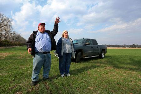 Art and Helen Tanderup talk about where the Keystone XL Pipeline will cut through the farm that has been in his wife, Helen's family for more than 100 years near Neligh, Nebraska, U.S. April 12, 2017.  REUTERS/Lane Hickenbottom
