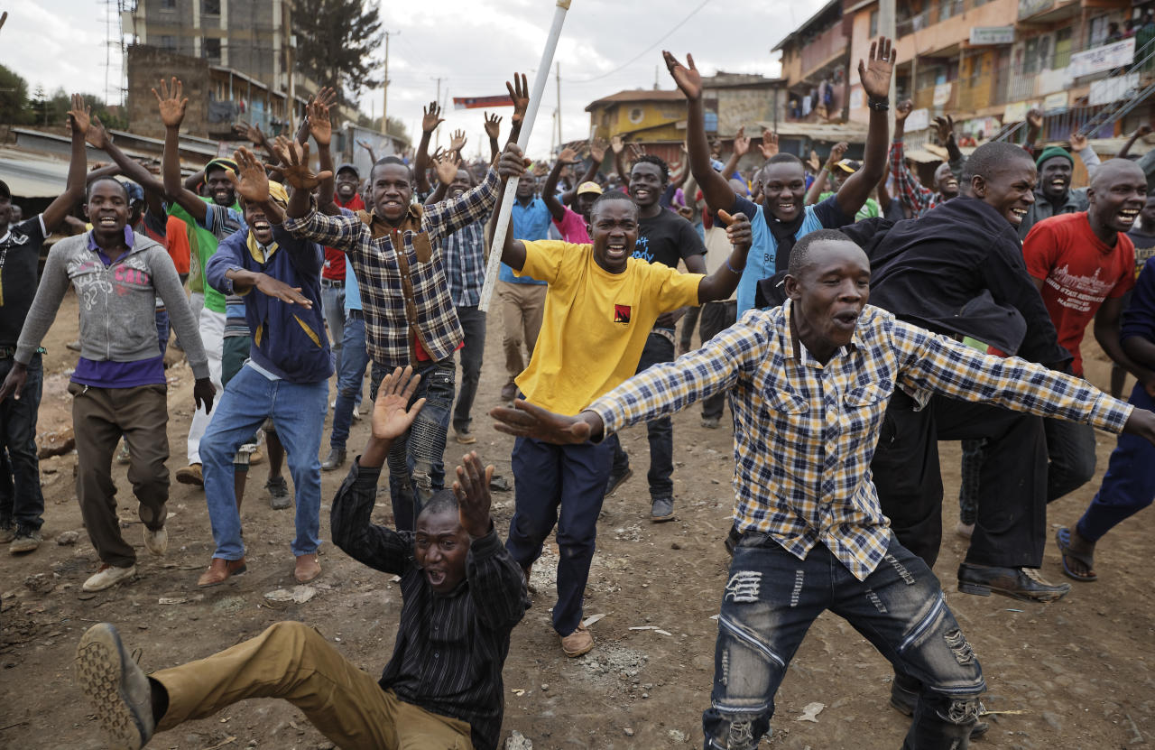 <p>Protesters who had been engaged all day in clashes with riot police, erupt in celebration after hearing news from an opposition press conference which they interpreted as meaning opposition leader Raila Odinga would become president, in the Kawangware slum of Nairobi, Kenya Thursday, Aug. 10, 2017. Kenyan opposition official Musalia Mudavadi claimed Thursday that election commission data shows Odinga won Tuesday's election and that he should be declared president. (Photo: Ben Curtis/AP) </p>