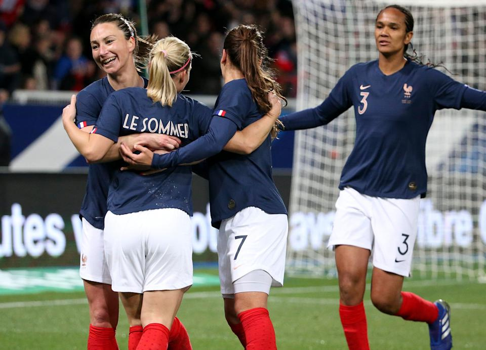 AUXERRE, FRANCE - APRIL 4: Eugenie Le Sommer of France celebrates her goal with Gaetane Thiney, Wendie Renard during the international friendly match between France and Japan at Stade de L'Abbe-Deschamps on April 4, 2019 in Auxerre, France. (Photo by Jean Catuffe/Getty Images)
