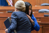 Rep. Pramila Jayapal, D-Wash., right, is hugged by Chair Rep. Carolyn Maloney, D-N.Y., Thursday, Sept. 30, 2021, as she arrives to testify about her abortion decision during a House Committee on Oversight and Reform hearing on Capitol Hill in Washington. (AP Photo/Jacquelyn Martin)