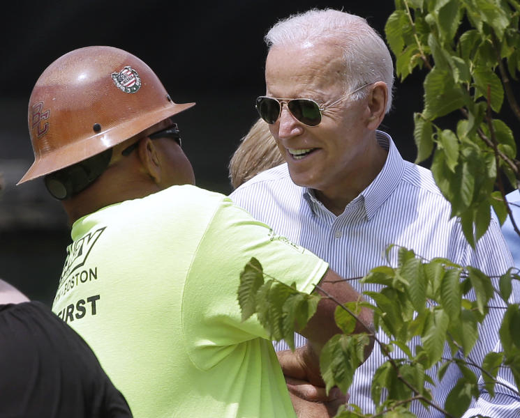 Former vice president and Democratic presidential candidate Joe Biden speaks to a worker on Wednesday, June 5, 2019, at a park in Boston being constructed in honor of Martin Richard, the youngest victim of the 2013 Boston Marathon bombings. (AP Photo/Steven Senne)