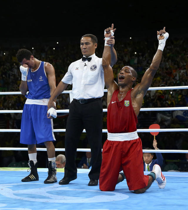 <p>Robson Conceicao of Brazil celebrates after winning his bout against Sofiane Oumiha of France in the men's light (60kg) final at the Rio Olympics on August 16, 2016. (REUTERS/Peter Cziborra) </p>
