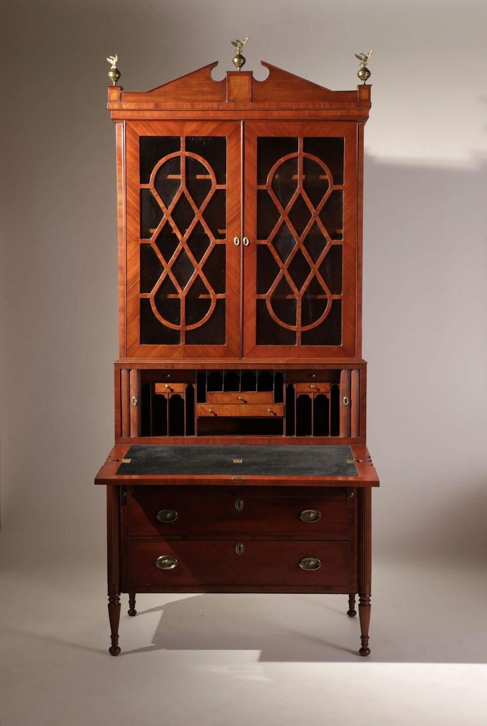 """<p>""""This secretary bookcase from <a href=""""https://www.liverantantiques.com/"""" rel=""""nofollow noopener"""" target=""""_blank"""" data-ylk=""""slk:Nathan Liverant"""" class=""""link rapid-noclick-resp"""">Nathan Liverant</a> has many wonderful assets. It will add architecture to any room, and the inventive pierced door grilles are, as they say, motion-filled. The timber is very fine and beautiful."""" —<em>Thomas Jayne</em></p>"""