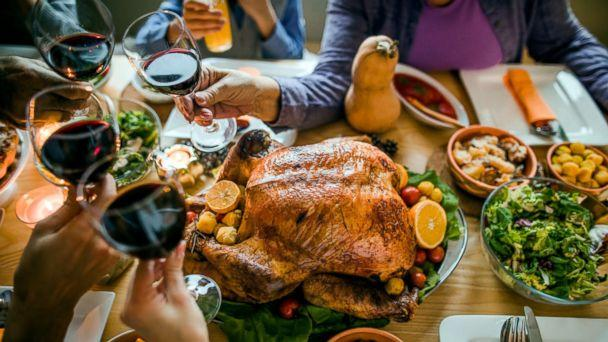 PHOTO: This stock photo depicts a family toasting with a glass of wine before enjoying a Thanksgiving meal. (STOCK/Getty Images)