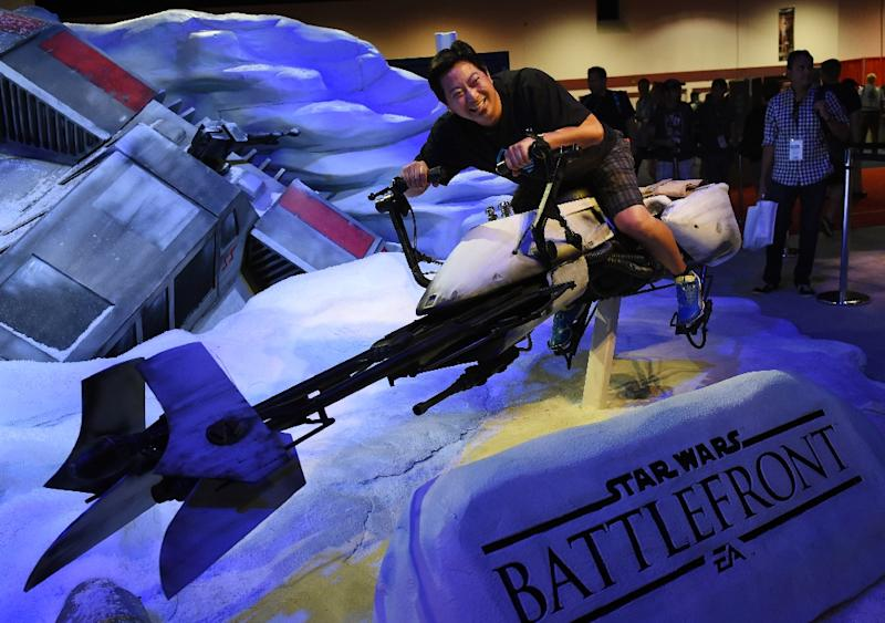 A Disney fan rides a Star Wars display at the Disney D23 EXPO 2015 in Anaheim, California, August 14, 2015 (AFP Photo/Mark Ralston)