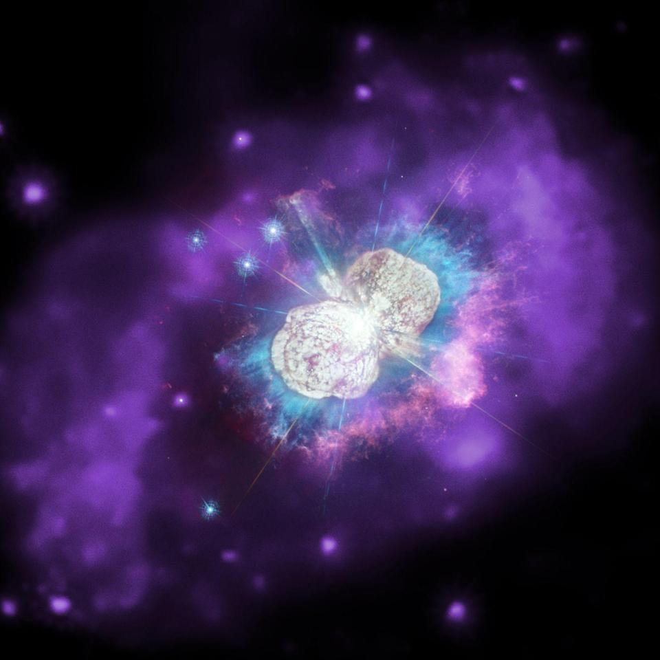 """<p>Chandra teamed up with Hubble to snap this incredible image of <a href=""""https://www.popularmechanics.com/space/a23442/largest-stars-in-the-galaxy-lashing-each-other-with-stellar-wind/"""" rel=""""nofollow noopener"""" target=""""_blank"""" data-ylk=""""slk:Eta Carinae"""" class=""""link rapid-noclick-resp"""">Eta Carinae</a>, a stellar duo of orbiting stars in the midst of a death spiral. Astronomers believe these twirling stars, which are found in our own galaxy, <a href=""""https://www.popularmechanics.com/space/deep-space/a25221758/two-young-stars-death-spiral/"""" rel=""""nofollow noopener"""" target=""""_blank"""" data-ylk=""""slk:may soon go supernova"""" class=""""link rapid-noclick-resp"""">may soon go supernova</a> together. </p>"""