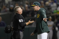 Oakland Athletics manager Bob Melvin, right, reacts after being ejected by umpire Greg Gibson (53) during the sixth inning of a baseball game between the Athletics and the Seattle Mariners in Oakland, Calif., Wednesday, Sept. 22, 2021. (AP Photo/Jeff Chiu)