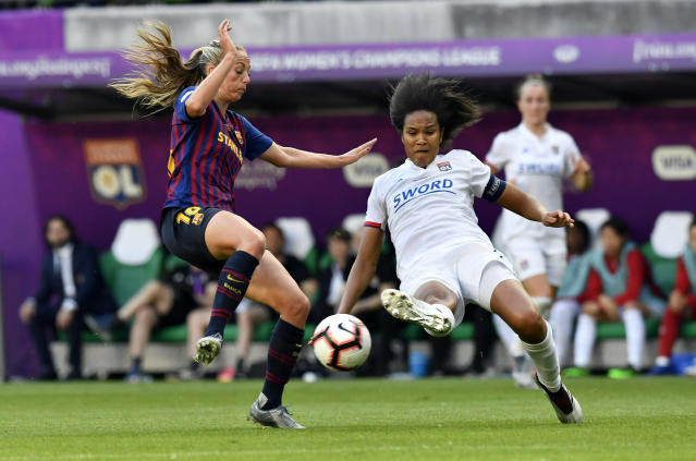 Wendie Renard of Lyon, right, in action against Toni Duggan of Barcelona, left, during the women's soccer UEFA Champions League final match between Olympique Lyon and FC Barcelona at the Groupama Arena in Budapest, Hungary, Saturday, May 18, 2019. (Tibor Illyes/MTI via AP)