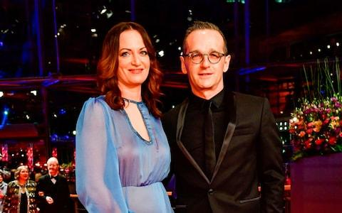 Heiko Maas and his partner German actress Natalia Woerner  - Credit:  TOBIAS SCHWARZ/ AFP