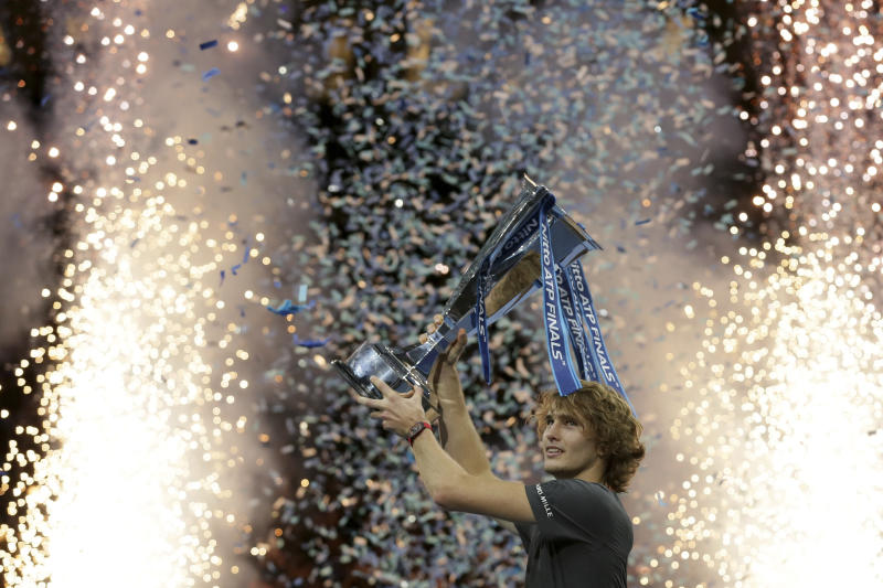 FILE - In this Sunday Nov. 18, 2018 file photo, Alexander Zverev of Germany holds up the trophy after defeating Novak Djokovic of Serbia in their ATP World Tour Finals singles final tennis match at the O2 Arena in London. The ATP Finals is moving to the Italian city of Turin in 2021, the ATP is expected to announce the move Wednesday April 24, 2019. (AP Photo/Tim Ireland, File)