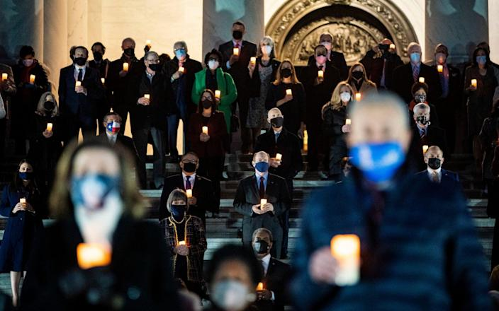 Members of Congress observe a moment of silence on the steps of the US Capitol - Al Drago/Getty