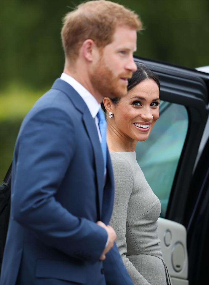 <p>After visiting the Presidential mansion on the second day of their visit in Dublin on July 11, Meghan can't take her eyes off Harry. Photo: Getty </p>